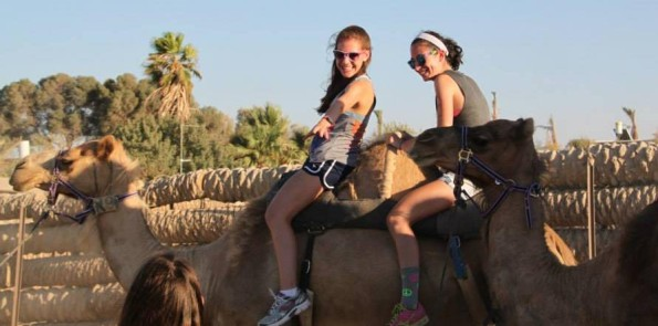 Sarah Krieger with her friend enjoying a camel ride
